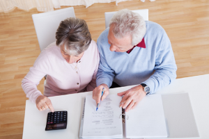 Image of a senior couple working on their retirement planning