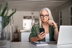 Image of a senior woman using technology