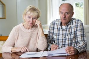 Image of a concerned senior couple calculating their portfolio's beta