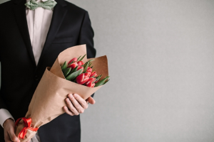 Image of a senior man with a bouquet of flowers