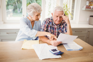 Image of a senior couple managing their finances