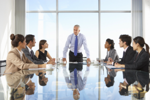 Image of a CEO discussing stock buybacks with his team