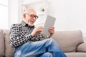 Image of a pleased senior man reading