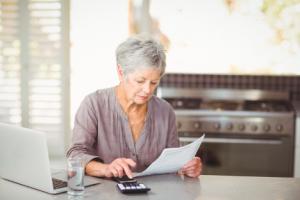 Image of a senior using a calculator