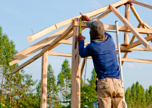Image of a man building a house
