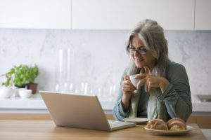 Image of a senior woman working on her laptop